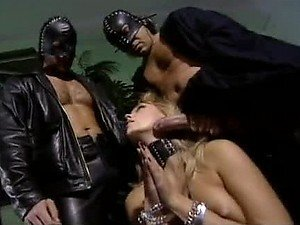 Three Leather Masked Studs Gangbang The Sexy Blonde Ellen Saint