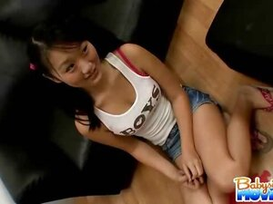 Asian innocent babysitter Evelyn shows off her tiny tits and clit