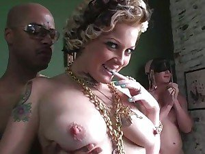 Sexy blonde Candy Monroe between white and black cocks