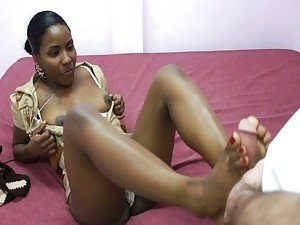 Ebony uses feet to get white cock hard