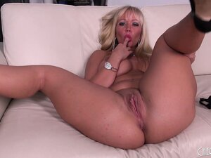 Slighty chubby blonde Austin Taylor fingers and toys her cunt