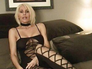 Short haired momma in sexy outfit plays with sex toys