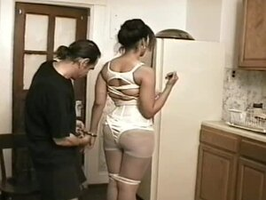 Housewife tied up in the kitchen