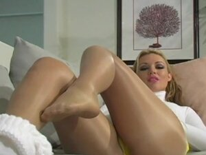 Sexy beauty in nylons and slender legs posing so erotic