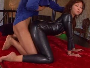 Kaori In A Tight Latex Suit having wild sex on a bed