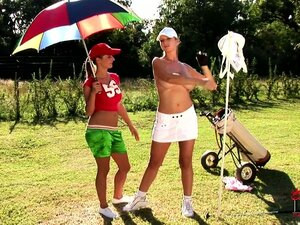 Busty babe and her sexy caddie play with their tits on the golf course