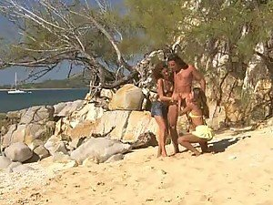 Blonde and Redhead Having Fun At the Beach with a Cock
