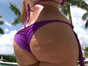 Curvy Latina bikini girl laid outdoors