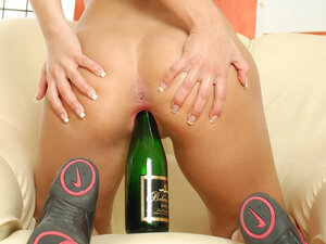 Teeny rides a champagne bottle