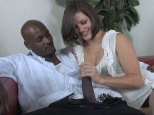 Bobbi Starr doing a hard handjob for a black guy