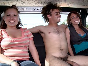 A fucker with a huge hose gets two chicks to join him in the back of his van for sex