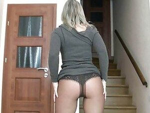Handsome blonde cougar in tight dress and pantyhose strips
