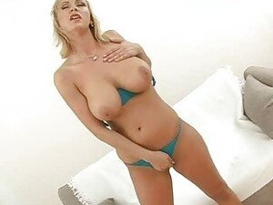 Heavy chested blonde babe does hot striptease and titjob