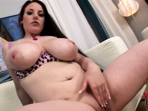 The hottie spreads her curvy body all over the couch and plays with her pussy
