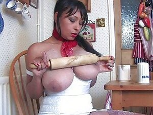 Randy housewife with huge tits plays with her muffins in kitchen