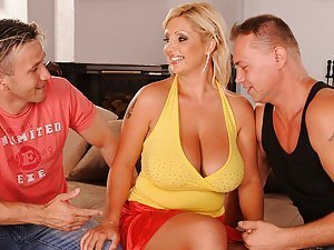 Watch as Chintia Flower seduces Bob Terminator and Choky Ice with her sexy huge boobs. Chintia makes them suck on her nipples and lick her wet pussy. Then she alternately suck those two throbbing dicks and gets fucked by the two stiff cocks ending up in a