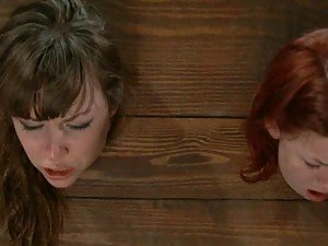 Redhead And Brunette Girls Crave over A Boner In BDSM Clip