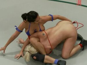 Two horny girls are wrestling and fucking each other
