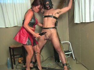 Horny mom giving electric shocks to her slave's tied up balls !