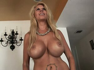 Blonde cougar with a massive set of titties bangs a young punk