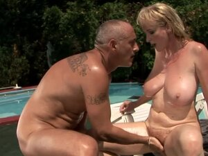 Busty mature blonde Monik gets amazingly fucked on the poolside