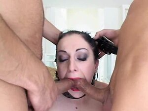 Slutty Renee Pornero fills her mouth with two huge cocks