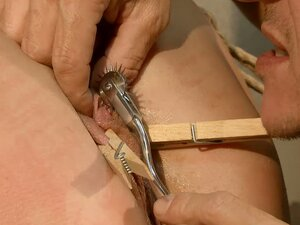 Torture Master Playing with Vivian Bianchy's Cunt in BDSM Clip