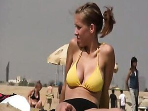 Hidden camera on the beach shows all the beauty of the young blonde babe.