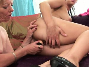Lesbian grandma and her much younger girlfriend playing with a dildo