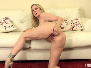 The divine blonde Julia Ann relishes the sweet taste of her pussy on her fingers