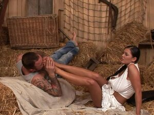 Jasmine Black gets a load of cum over her legs in the hayloft
