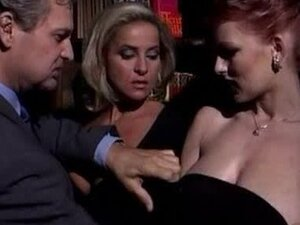 Two bosomy Italian chicks suck a cock before taking it in their holes