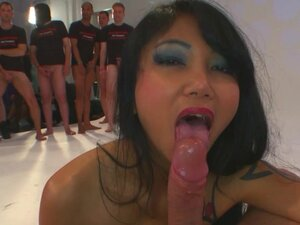 Busty babe in asian gang bang