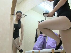 Seducing long haired Asian spied changing in changing room