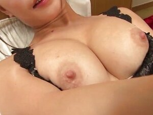 Yayoi Yanagida in a lacey bra plays with her