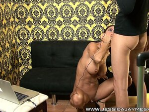 Muscular brunette with big tits gives a blowjob during a camshow