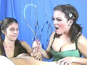 Two horny teens with pigtails learn to to give a handjob