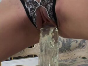 Bunny the horny blonde toys her pussy with huge glass dildo