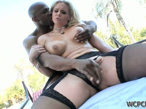 In the outdoors, the horny and lustful blonde enjoys her time with a big black prick