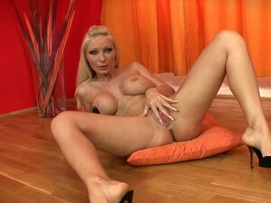 Blonde with high heels is drilling her cunt