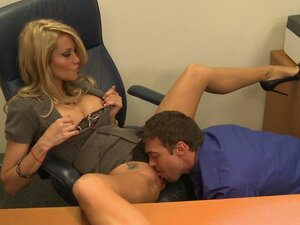 Slutty business woman Jessica Drake rides a stiff cock of her employee