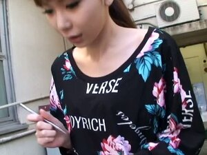 Confused Japanese girl shows her entire chest to a spy cam