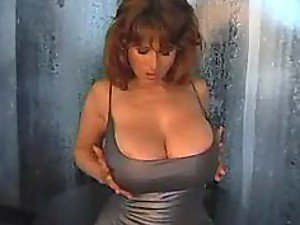 busty mature chloe in a silver dress