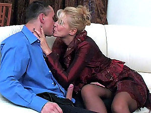 Blond mature lady seduces the visitor in the office