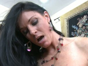 Strampet India Summer spits on a cock and sucks it before riding on top