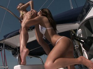 On a boat and with the sun on their skin two sexy babes fulfill their desires
