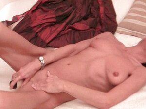 Skinny mature beauty rubs her old pussy
