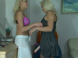 Two blonde babes loving strap on fucking action