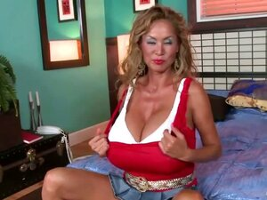 Mature with huge tits
