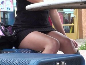 Pretty babe is getting upskirt on the street
